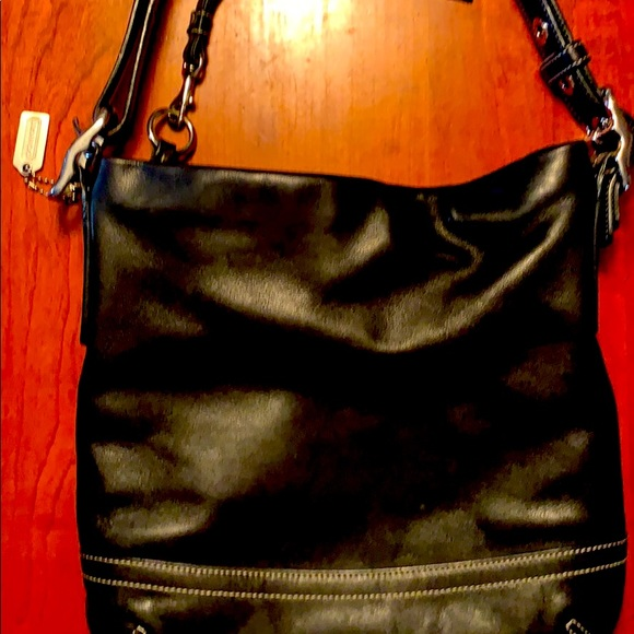 Authentic Coach crossbody/shoulder bag.